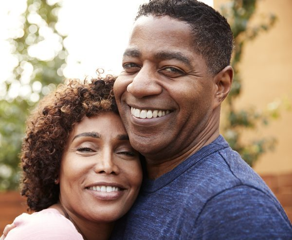happy-middle-aged-black-couple-embracing-smile-to-YZBLCP3-e1579480445926.jpg